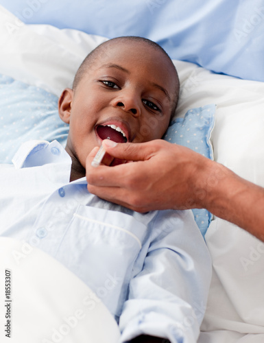 Small Boy sick in bed