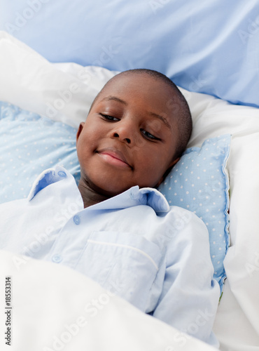 Little boy sick in bed