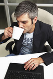 Young entrepreneur drinking cofee poster