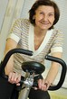 Spinning senior fitness woman indoors