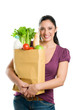 Young woman holding a grocery bag
