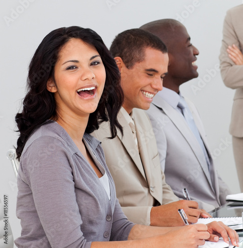 Businesswoman in a meeting smiling