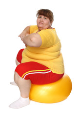 exercising overweight woman on ball