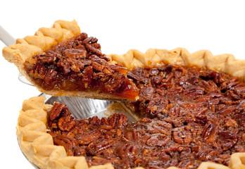 A whole pecan pie on white