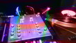a pan across dj turntables with abstract light patterns