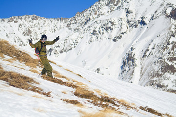 Snowboard freeride on the slope mountain Cheget.