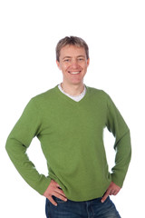 smiling man in green pullover