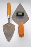 builders trowels and level.