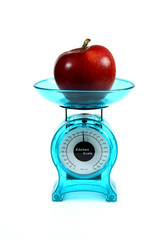 apple on a kitchen scale - diet concept