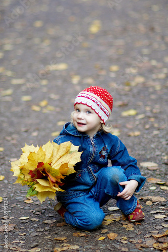 The girl with yellow leaves