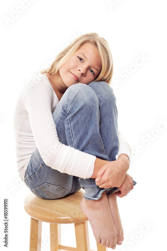 Girl on a wooden stool