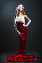 portrait of a  christmas woman in beauty red dress