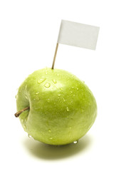 green apple with flag in front of white background
