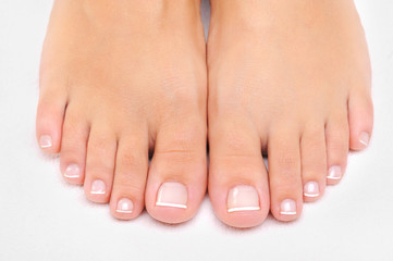 female feet with the French pedicure