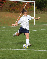Teen Soccer Player In Action