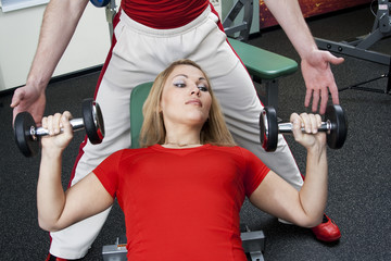 The woman is engaged in fitness in sports club