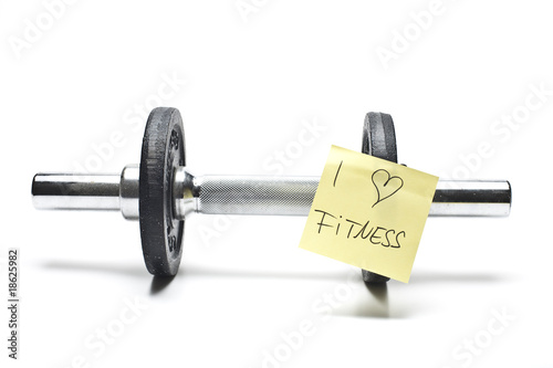 free weights with note in front of white background