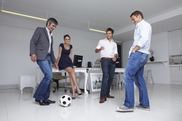 Business team playing football
