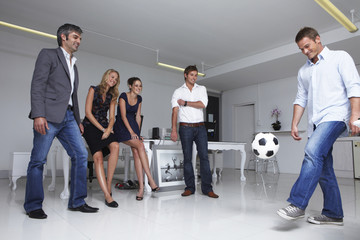 Businessman playing football