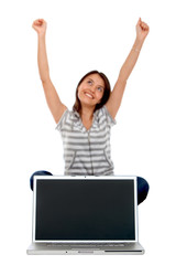 Excited woman with laptop