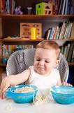 Little boy investigating pasta poster
