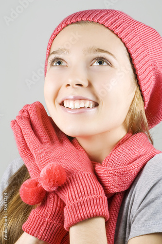 Girl in winter clothing looking up