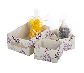 fancy gift boxes with some clews in them