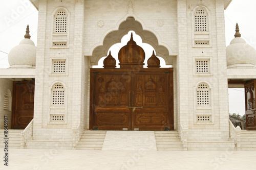 Wooden gate to a holy temple in India, Rajasthan India