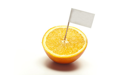 "sliced orange with flag ""100% fresh"" in front of white backgroun"