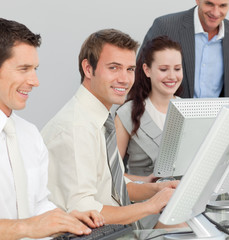 Businessman and his colleagues working with computers in an offi