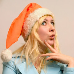 scared girl with Santa's cap
