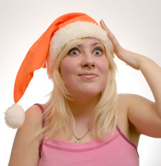 scared girl with Santa's cap