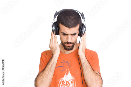 young man listening music with headphones
