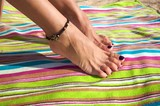 woman ankle with bracelet poster