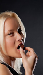 Attractive girl eating chocolate