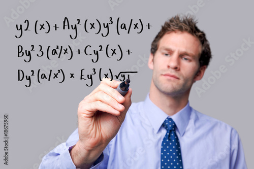 Teacher writing a maths equation.