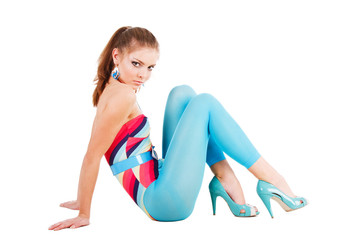 Charming young girl in blue on floor
