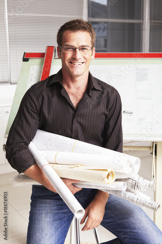Young man with architect plans