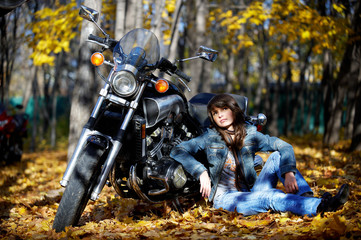 The girl the brunette on the earth about a motorcycle