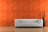 white sofa and vase with dry wood in front of orange wall