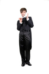 A young man in a black tailcoat is holding the stick, isolated