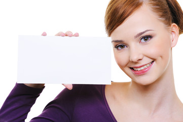 Pretty smiling girl with blank card
