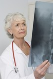 Senior medical practitioner examines xray