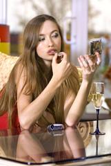 pretty girl puts on somebody's lipstick