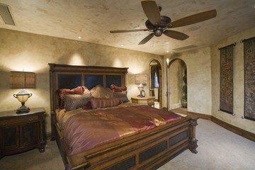Silk bedcover on antique bed in Palm Springs home