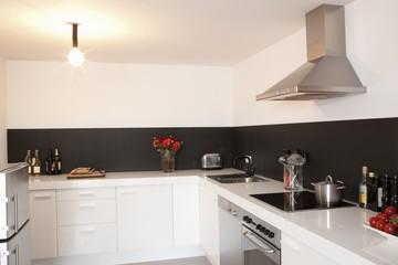 Minimalist kitchen with bare light
