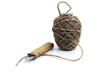 Ball of thick string and knife