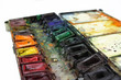 well-used paintbox with selected focus