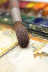 well-used brush in over paintbox