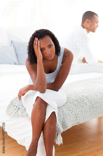 Upset couple sitting on the bed